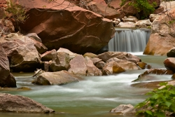 This nature image of a small waterfall was taken walking up the path from the Temple of Sinawava, in Zion National Park. There were people all around and yet this image still conveys the peaceful mood I felt being there. This is limited to 99 prints. If interested in a custom frame and mat with the print please contact me.